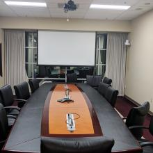 Formal conference room with remote meeting technology